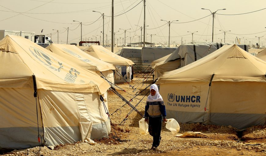 A girl walking in a refugee camp